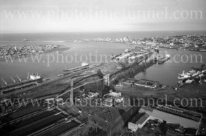 Aerial view of Newcastle Harbour, NSW, showing coal loader at Carrington, May 1974.