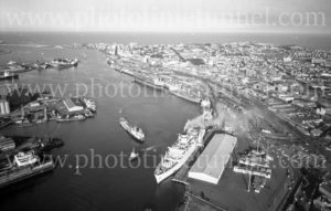 Aerial view of Newcastle Harbour, NSW, showing shipping at Lee Wharves, May 1974.
