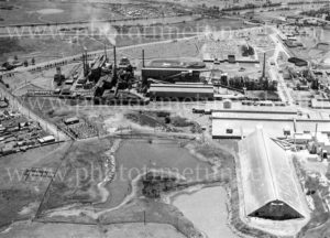 Aerial view of Sulphide Corporation's lead and zinc smelter at Cockle Creek, Lake Macquarie, NSW, 1977.