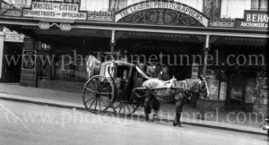 Hansom cab outside Thornton Richards photographic store in Sturt Street, Ballarat, Victoria, 20-9-1947.