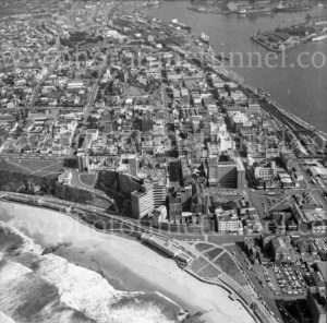 Aerial view of Newcastle, NSW, showing beach, Royal Newcastle Hospital and harbour, 1974.