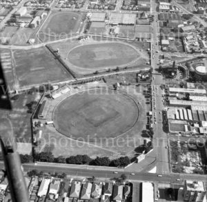 Aerial view of Union and Parry Streets, Newcastle, NSW, showing the sportsgrounds. 1974.