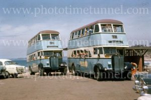 School pupils in double-decker buses at the beach, Newcastle, NSW, 1960s.