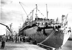 Immigrants arriving on the ship Fairsea, Newcastle Harbour, NSW, 1949.