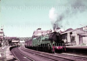 Steam locomotive 3813 leaving Newcastle Station, Newcastle, NSW, circa 1960s.