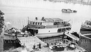 Riverboat MV Mulgi at a wharf on the Clarence River, circa 1940s.
