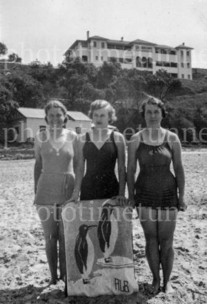 Three women on the beach at Yamba, NSW, circa 1940s.