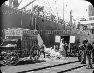 Riverstone Meat Co wagons delivering meat to a ship for export, circa 1900.