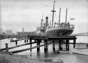 """Ship City of Bagdad at """"the Dolphins"""", Newcastle, NSW, circa 1930s."""