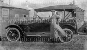 George Hunt, taxi driver, with his cab in Newcastle, NSW, circa 1920