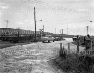 Railway level crossing at Adamstown NSW, January 15, 1963.