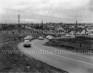 Railway level crossing at Adamstown NSW, May 6, 1964.
