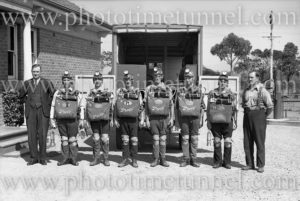 """Mines rescue workers wearing """"Proto"""" breathing apparatus at Boolaroo mines rescue station, NSW, December 23, 1937."""