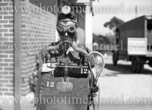 """Mine rescuer wearing """"Proto"""" breathing gear at Boolaroo mines rescue station, NSW, December 23, 1937."""
