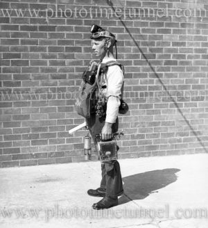 """Mine rescuer wearing """"Proto"""" breathing gear at Boolaroo mines rescue station, NSW, December 23, 1937. (2)"""