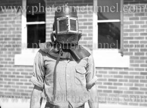 Mines rescue worker modelling a protective mask at the Boolaroo mines rescue station, NSW, December 23, 1937.