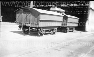 Coupled hearse trailers for Newcastle trams at Hamilton depot, 6-3-1947.