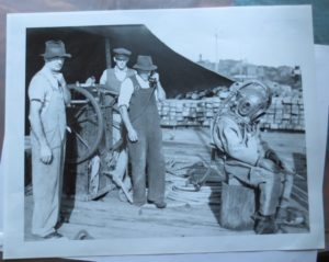 Diver in full gear and helmet on the wharf at Newcastle, NSW, 1940s. Sale item.