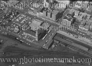 Aerial view of Newcastle East (NSW) showing Customs House, railway station, Great Northern Hotel, George Hotel. 1975.