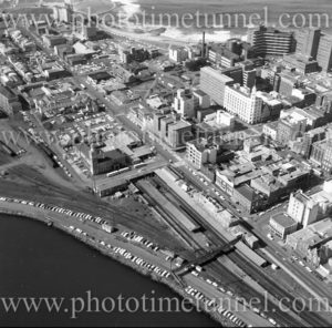 Aerial view of Newcastle East (NSW) showing Customs House, railway station, Great Northern Hotel, George Hotel, Royal Newcastle Hospital. 1975.