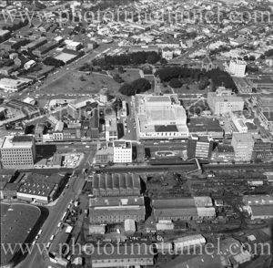 Aerial view of Newcastle Civic precinct (NSW) showing Roundhouse under construction, Civic Park and Honeysuckle area. 1975. (2)