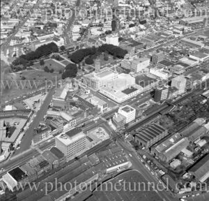 Aerial view of Newcastle Civic precinct (NSW) showing Roundhouse under construction, Civic Park and Honeysuckle area. 1975.