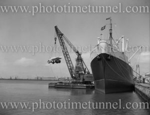 Euclid trucks being unloaded from ship Middlesex, Newcastle Harbour, NSW, December 12, 1959. (4)