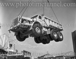 Euclid trucks being unloaded from ship Middlesex, Newcastle Harbour, NSW, December 12, 1959.