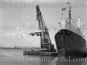 Euclid truck being unloaded from ship Middlesex, Newcastle Harbour, NSW, December 12, 1959. (2)