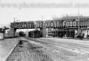 Steam tram passing beneath the AA company rail bridge in Hunter Street, Newcastle, NSW, circa 1920.