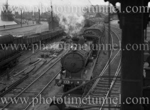 Locomotive 3331 hauling passenger train at Newcastle, NSW, circa 1936.