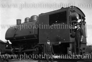 Men with industrial saddle-tank engine, numbered 10.