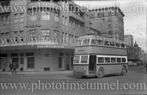 Double-decker trolley bus near the Hyde Park Hotel, Sydney, NSW, circa 1940s.