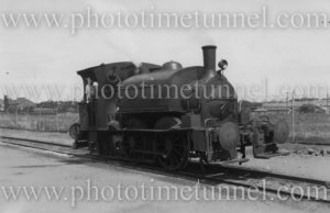 """Stewarts and Lloyds industrial saddle-tank engine """"Green Hornet"""" at Newcastle, NSW, circa 1960."""