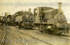 Men with industrial steam locomotives.