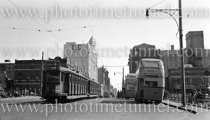 Trams and buses in Newcastle East (NSW), near Pacific Park, August 20, 1949.