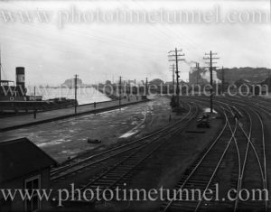 View of Newcastle East (NSW) waterfront, showing Nobbys and power station, circa 1930s.