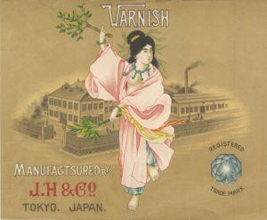 Vintage Japanese varnish label, dancing woman on gold background.