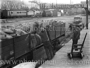 Loading sacks on rail cars, Newcastle waterfront, circa 1930s.